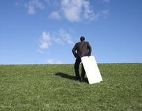 Standing man and board Royalty Free Stock Image