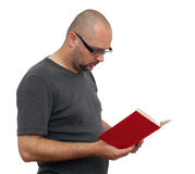 Standing man in glasses reads book Stock Photography