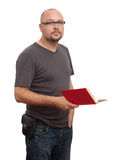 Standing man in glasses reads book Stock Image