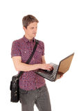 Standing man with laptop. Royalty Free Stock Image