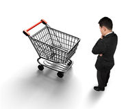 Standing man looking at shopping cart top view Royalty Free Stock Image
