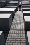 Standing Man at the Memorial to the Murdered Jews of Europe. Man standing respectfully at the Memorial to the Murdered Jews of Europe in Berlin Stock Photography