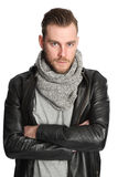 Standing man with scarf and leather jacket Royalty Free Stock Photography