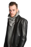 Standing man with scarf and leather jacket Royalty Free Stock Photos
