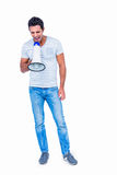 Standing man shouting through megaphone Stock Image