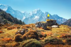 Standing man on the stone and looking on amazing Himalayan mount Stock Images