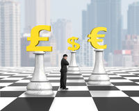 Standing man thinking with money chess on chessboard Stock Photos