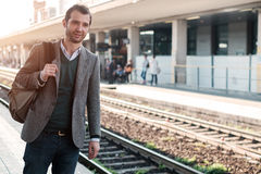 Standing man waiting for the train. In a train station platform Royalty Free Stock Photography