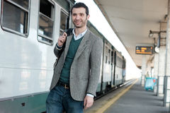 Standing man waiting for the train Royalty Free Stock Images