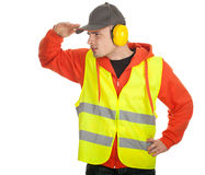 Standing manual worker looking for something Royalty Free Stock Images