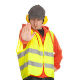Standing manual worker stopping Royalty Free Stock Image