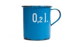 Standing measuring jug of enamel Stock Photo