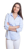 Standing mexican businesswoman with crossed arms Stock Photo