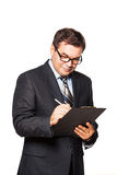 Standing Middle Aged Businessman Writing in File Royalty Free Stock Photography