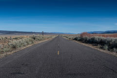Standing in the MIddle of Desert Road and Blue Sky Royalty Free Stock Images