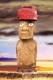 Standing moai with red stone hat and large eyes in Easter Island, Chil Stock Photo