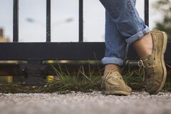 Standing in Moccasins and Blue Jeans Stock Image