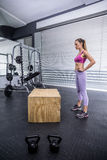 Standing muscular woman resting herself Stock Photography