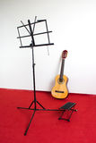 Standing music sheet and guitar Stock Photo