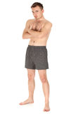 Standing naked young man Royalty Free Stock Photos