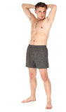 Standing naked young man Stock Photos