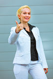 Standing at office business woman showing thumb up Stock Photography