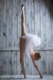 Standing on one toe. Graceful ballerina in tutu lifted her leg up high, standing on one toe Royalty Free Stock Image