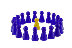 Standing out. Single yellow figure standing in a blue crowd Stock Photos