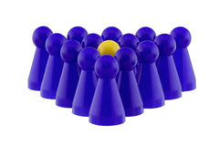 Standing out. Single yellow figure standing in a blue crowd Royalty Free Stock Image