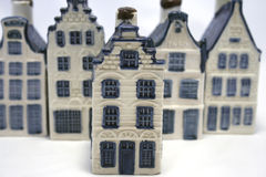 Standing out. One delft blue ceramic house standing out in a row of similar ones. Part of a series Royalty Free Stock Photo