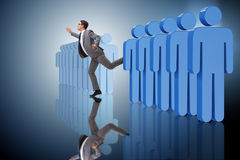 The standing out from crowd concept with businessman Royalty Free Stock Photo