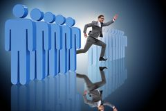 The standing out from crowd concept with businessman Stock Images