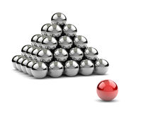 Standing Out of the Crowd Concept. Pyramid of Metallic Balls with One Red Separated on White Background 3D Illustration Royalty Free Stock Image