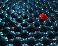 Standing out from the crowd concept. With umbrellas Stock Photography