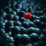 Standing out from the crowd concept. With umbrellas Stock Images