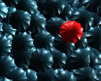 Standing out from the crowd concept. With umbrellas Stock Image