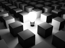 Standing Out Of The Crowd. 3D image of light bulb and boxes, representing a new idea Stock Photography