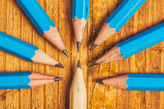 Standing out from the crowd with wood pencils on desk Royalty Free Stock Image