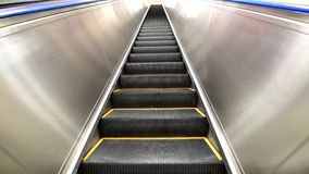Standing on Outdoor escalator. For moving in building stock footage