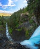 Standing over Brandywine Falls in Canada stock photos