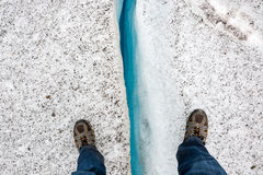 Standing over a crevice. In Switzerland Stock Images