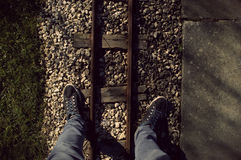 Standing Over A Miniature Railway Stock Photo