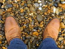Standing on the pebbles royalty free stock photo