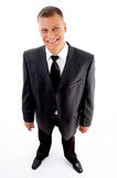 Standing pleased businessman Royalty Free Stock Photography