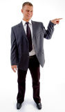 Standing pointing businessman looking at camera Royalty Free Stock Images