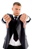 Standing professional with thumbs down stock images