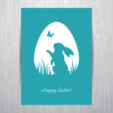 Standing rabbit silhouette in an egg shaped frame Stock Image