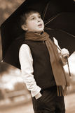 Standing in the rain. Sepia toned boy standing in the rain Royalty Free Stock Photos