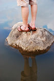 Standing on a Rock Stock Photo