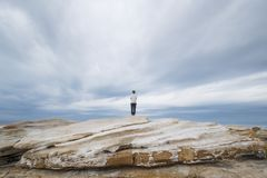 Standing on rock in nature royalty free stock images